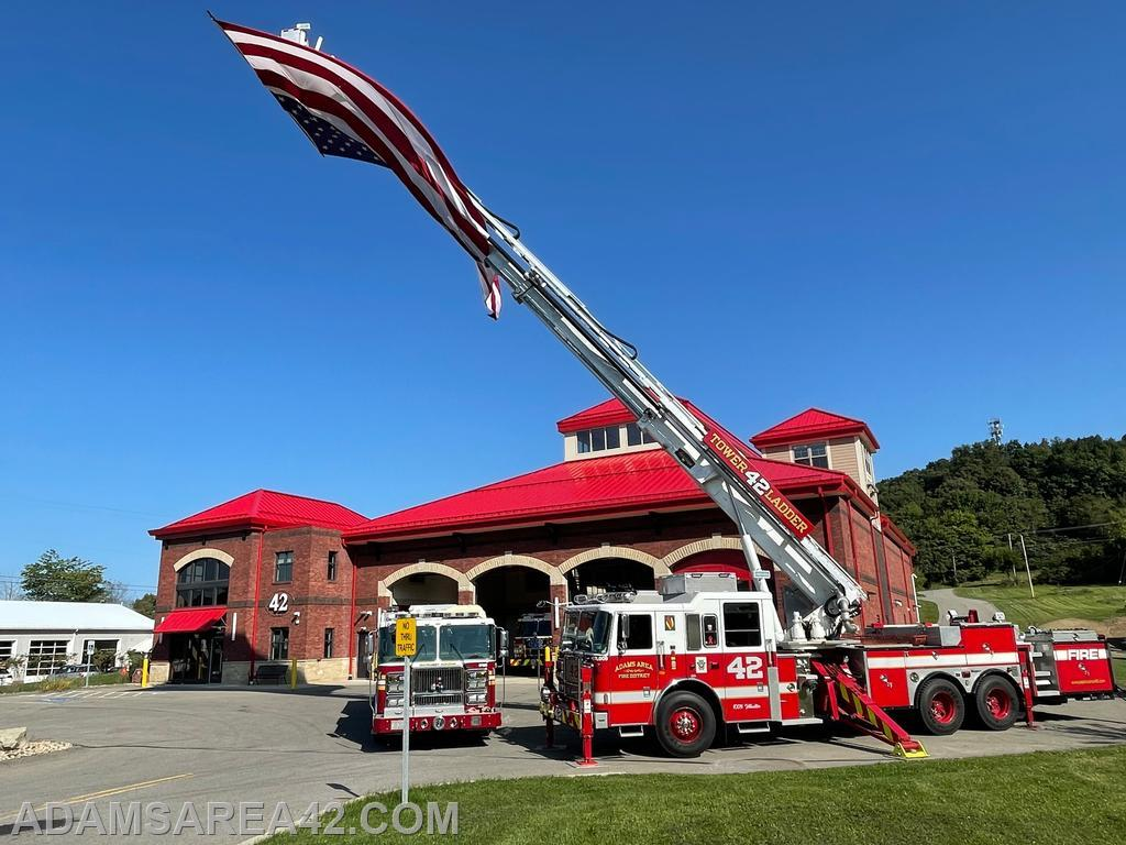 Tower 42 and Engine 42-2 in front of the AAFD HQ