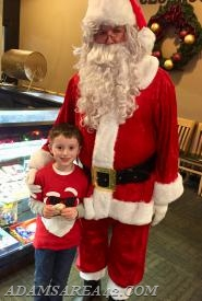 A happy youngster meeting Santa Claus!